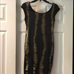 Black and gold open back with chain dress